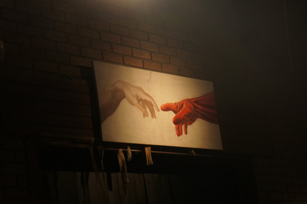 Creation of Adam by Michaelangelo... by Banksy