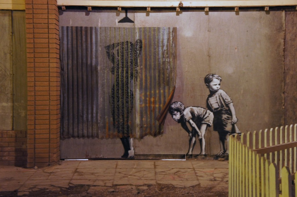 Woman taking her shower behind an iron curtain by Banksy