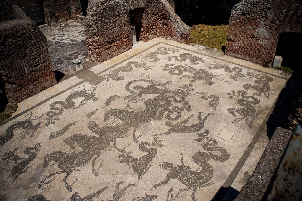 Black and white mosaic featuring Neptune, in the public baths of Ostia.